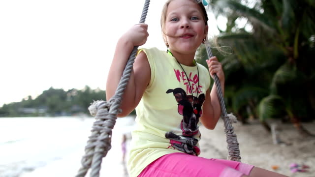 rope swing on a tropical beach. - trat province stock videos and b-roll footage