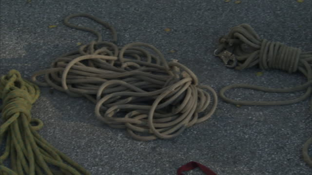 ropes and cables lie on the ground. - rope stock videos & royalty-free footage