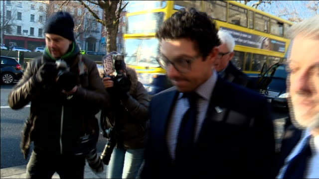 Rory McIlroy court arrival REPUBLIC OF IRELAND Dublin PHOTOGRAPHY *** Rory McIlroy from car and along and into court with press around / McIlroy into...