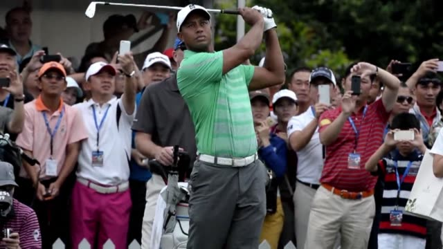 rory mcilroy finally tasted success for the first time this year when he beat an ailing tiger woods by one shot in a megabucks exhibition in china on... - tiger woods stock videos & royalty-free footage