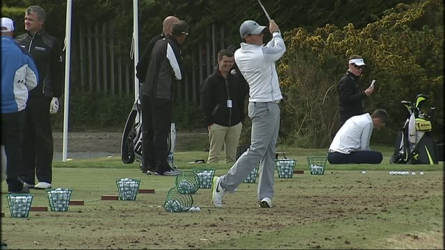 rory mcilroy injures his ankle just before the open championship file / date location unknown ext mcilroy hitting golf balls during practice - the open championship stock-videos und b-roll-filmmaterial