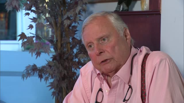 rory mcilroy injures his ankle just before the open championship int peter alliss interview sot sorry to hear he'd had an accident / bit foolish... - richard pallot stock-videos und b-roll-filmmaterial