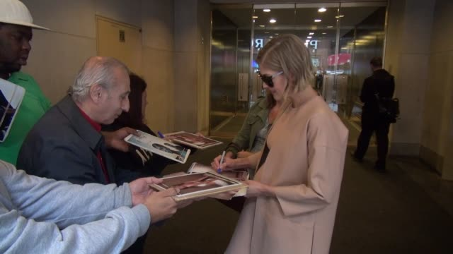 rosamund pike leaving the today show signs for and poses with fans on september 24 2014 in new york city - rosamund pike stock videos & royalty-free footage