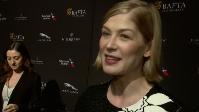 interview rosamund pike on being at the event on what makes the bafta tea party one of the most prestigious events of the weekend and on getting... - rosamund pike stock videos & royalty-free footage
