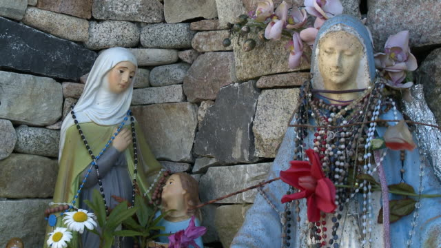 rosaries wrapped around statues of mary - effigy stock videos & royalty-free footage