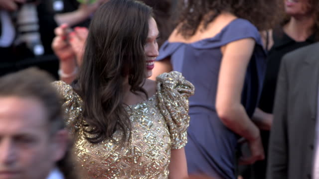 rosario dawson happily dancing, posing for paparazzi, greeting and talking to unidentified people on crowded red carpet at grand theater lumiere - rosario dawson stock videos & royalty-free footage