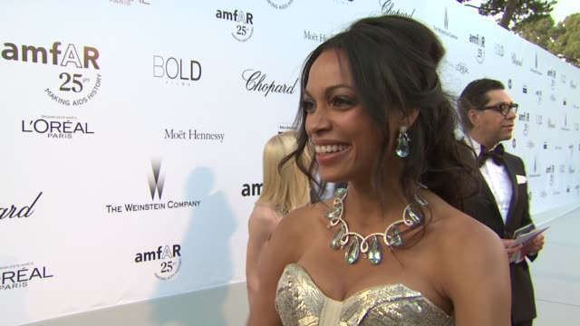 rosario dawson on what she is wearing on being at amfar at the amfar gala red carpet arrivals 64th cannes film festival at antibes - rosario dawson stock videos and b-roll footage
