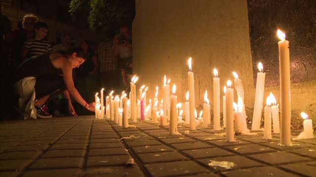 Rosario residents gathered for a candlelight vigil Wednesday evening in tribute to the five Argentine friends killed when an assailant acting in the...