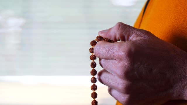 rosary beads. harmony. close-up of a man's hand holding a rosary while saying a prayer. religion - worry beads stock videos & royalty-free footage