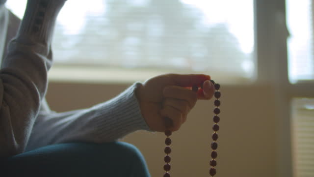 rosary beads. harmony. close-up of a person holding a rosary while saying a prayer. religion - islam stock videos & royalty-free footage