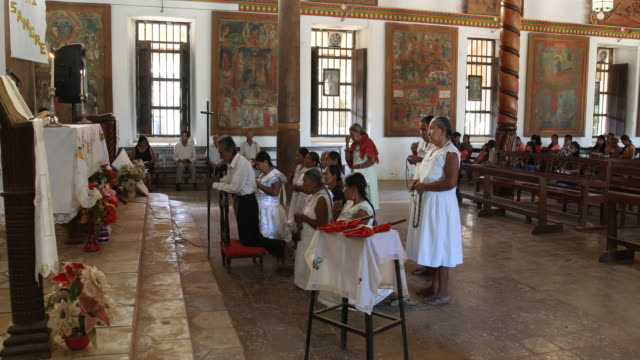 Rosary prayer of the Caciques before the holy mass in the catholic church of San Ignacio de Moxos