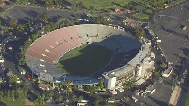 ws aerial pov rose bowl stadium with trees at pasadena, california - pasadena california stock videos and b-roll footage