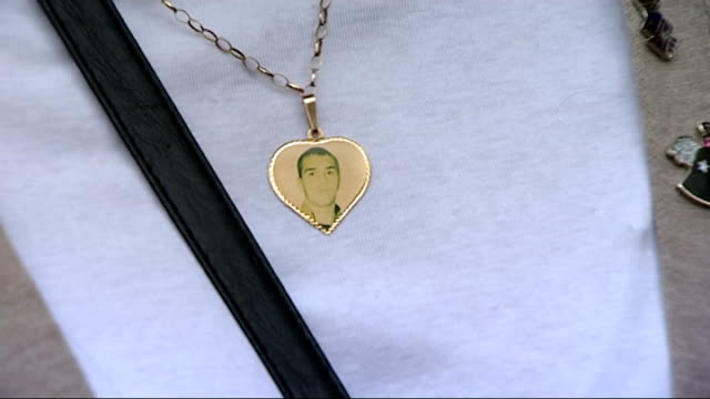 EXT Rose Gentle chatting with reporter and photograph of son worn on locket around kneck Rose Gentle interview SOT