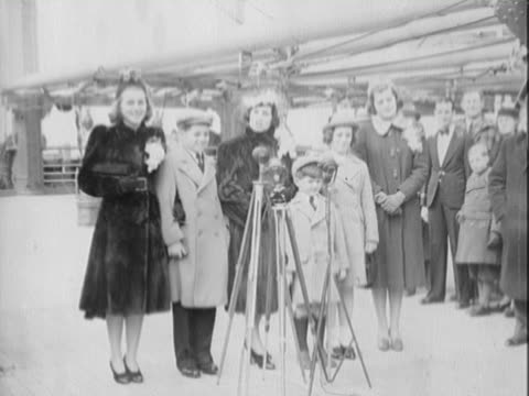stockvideo's en b-roll-footage met rose kennedy wife of ambassador joseph p kennedy sr talking and posing with five of her nine children to the press / eunice kennedy robert kennedy... - 1938
