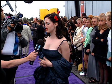 Rose McGowan at the 1997 MTV Movie Awards at Barker Hanger in Santa Monica California on June 7 1997