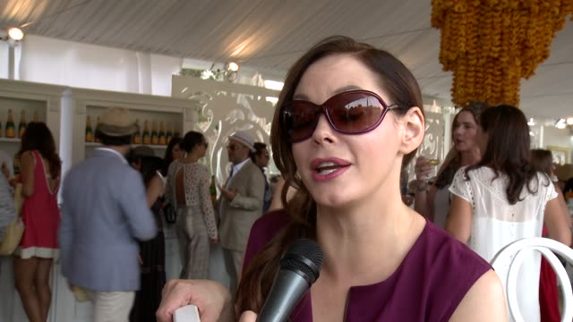 rose mcgowan on attending the event for the first time, if she's enjoyed a flute of veuve clicquot yet, all about her polo style, what she's working... - 出来事の発生点の映像素材/bロール