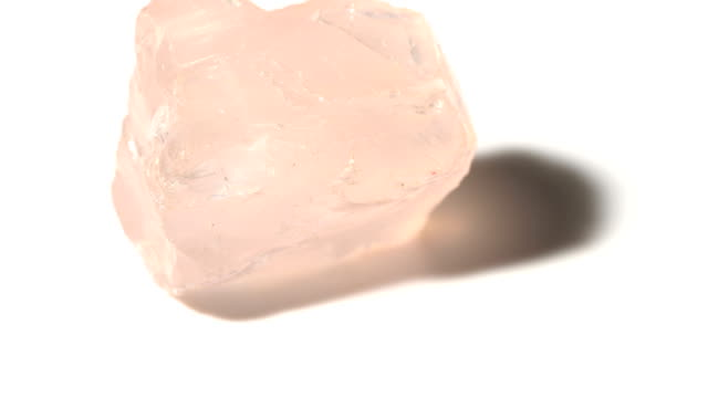 Rose Quartz mineral stone sample in rotation with white background