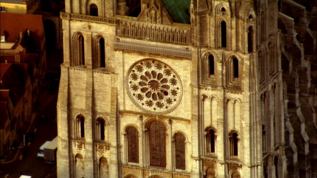 ha ms tu rose window and steeples of chartres cathedral / chartres, centre, france - rose window stock videos and b-roll footage