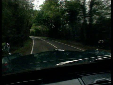 day 31 verdicts int car 'reconstruction' gloucs cms gloved hand starts car tcms hands on driving wheel as car along forward as car along country lane... - 評決点の映像素材/bロール