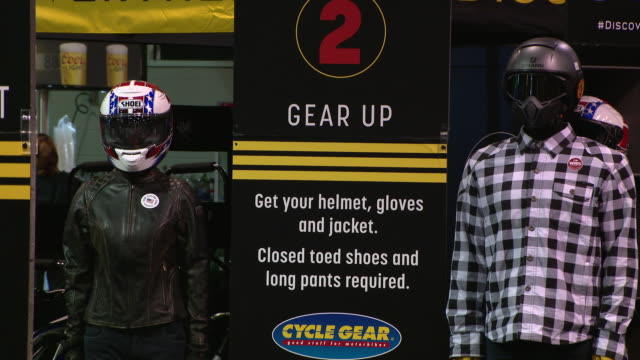wgn rosemont il us equipment for motorcyclists at progressive international motorcycle show in donald e stephens convention center on sunday february... - crash helmet stock videos & royalty-free footage