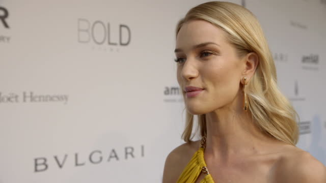 stockvideo's en b-roll-footage met rosie huntington-whiteley on being at amfar at amfar red carpet at hotel du cap-eden-roc on may 22, 2014 in cap d'antibes, france. - interview ruw materiaal