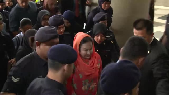 vídeos de stock, filmes e b-roll de rosmah mansor the luxury loving wife of malaysia's former prime minister arrives at court before being charged with money laundering linked to a... - ex