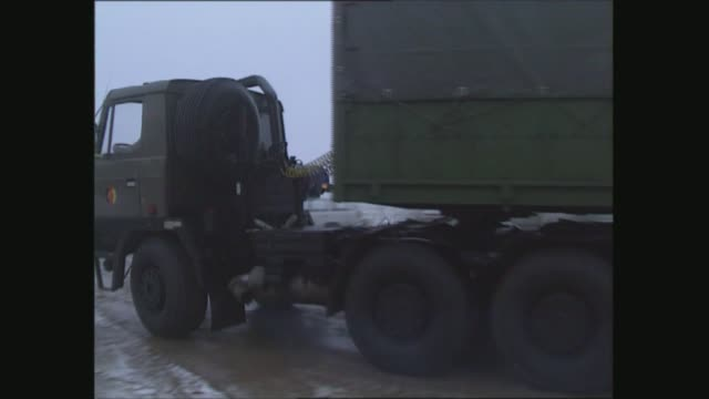rostock army base gvs; east germany: rostock army base: lorries leaving base; lorries along road; lorries through village: - east germany stock videos & royalty-free footage
