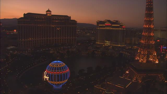 a rosy sky glows above the las vegas strip. - las vegas replica eiffel tower stock videos & royalty-free footage