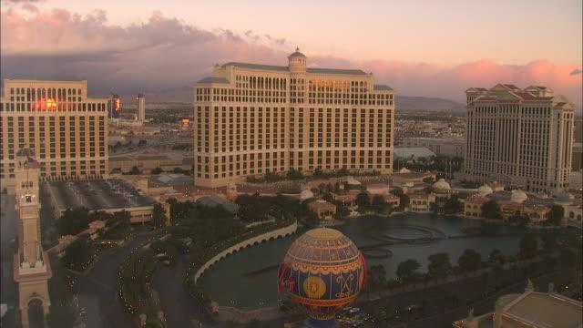 a rosy sky glows behind the las vegas strip. - las vegas replica eiffel tower stock videos & royalty-free footage