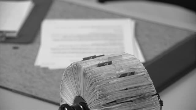 b/w cu rotary card file on office desk/ new york city - filing cabinet stock videos & royalty-free footage