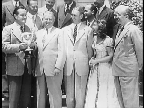 rotary club officials paramount executives barney balaban bob hope and paulette goddard assembled on steps at paramount studios / close up of harry... - paramount pictures stock videos & royalty-free footage