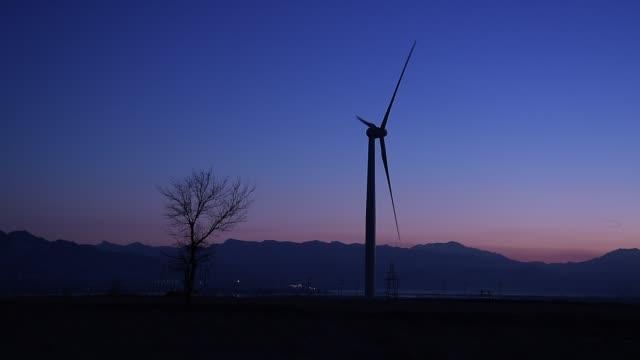 rotary wind turbine in beijing countryside - single tree stock videos & royalty-free footage
