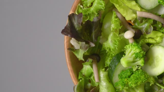 rotate of green salad bowl on white background - green salad stock videos & royalty-free footage