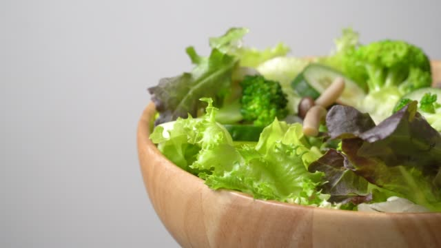 rotate of green salad bowl on white background - salad bowl stock videos & royalty-free footage