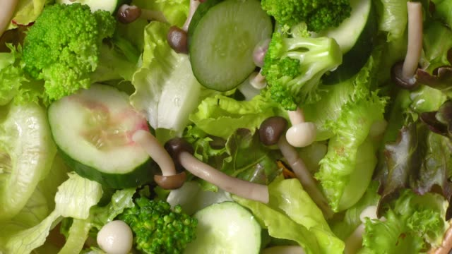 rotate of green salad close up background - green salad stock videos & royalty-free footage