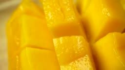 Rotate of mango slice. Closeup 4K