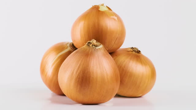 rotate onions - plain background stock videos & royalty-free footage