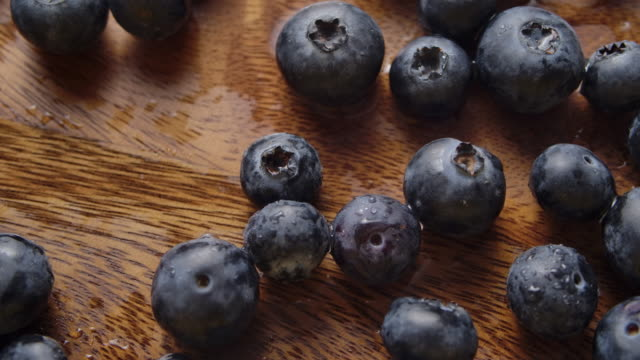 rotate shot of blueberries grapes falling on the wood table background studio shot - ascorbic acid stock videos & royalty-free footage