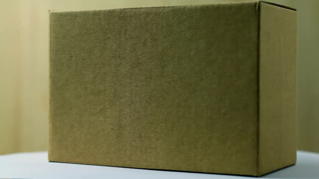 rotate:brown box - box container video stock e b–roll