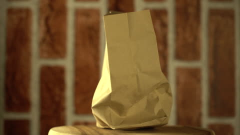 rotate:brown shopping bag - paper bag stock videos & royalty-free footage