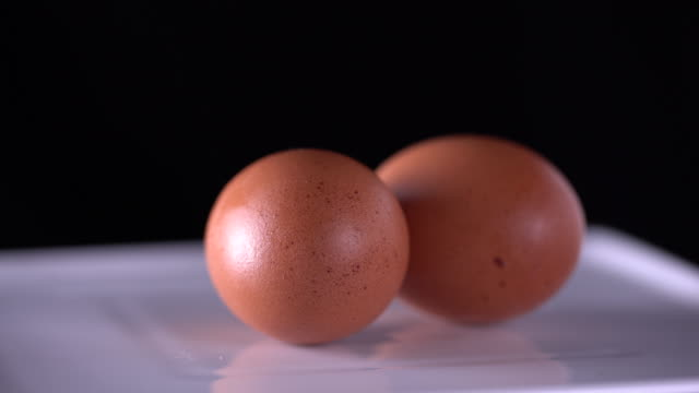 rotate:egg - egg yolk stock videos and b-roll footage