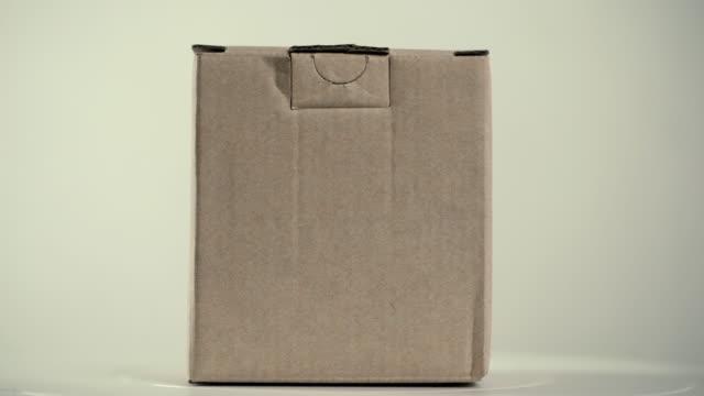 回転: 紙箱 - 荷造り点の映像素材/bロール
