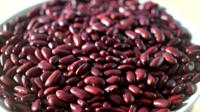 rotate/red beans stacked on wooden floor - bean stock videos & royalty-free footage
