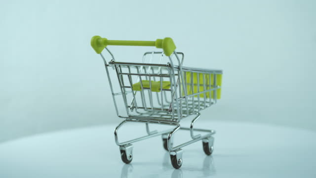rotate:shopping cart isolated spinning - shopping cart stock videos & royalty-free footage