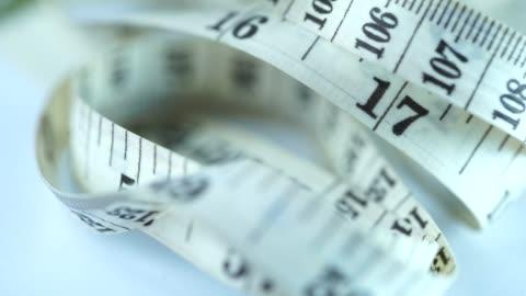 rotate:tape measure - tape measure stock videos & royalty-free footage