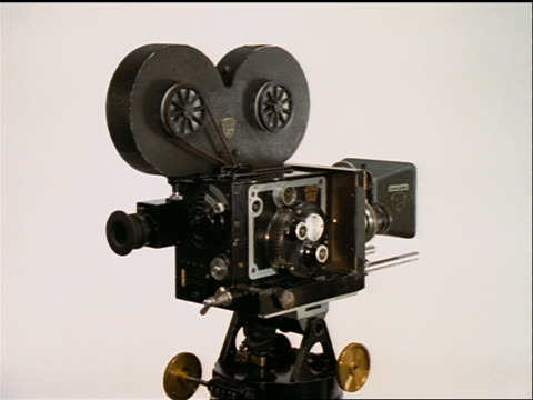 rotating 35mm mitchell film camera with white background - film camera stock videos & royalty-free footage