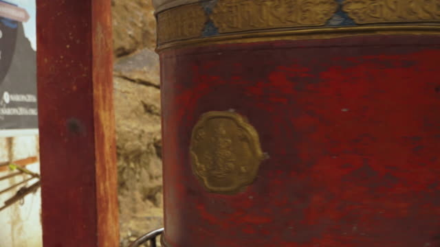 rotating a prayer wheel at mulbekh monastery - maroon stock videos and b-roll footage