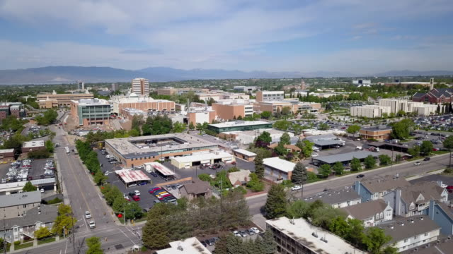 rotating aeraial view flying near brigham young university campus - provo stock-videos und b-roll-filmmaterial