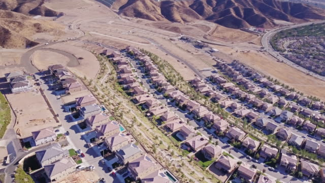 rotating aerial shot of suburban housing development - santa clarita stock videos & royalty-free footage