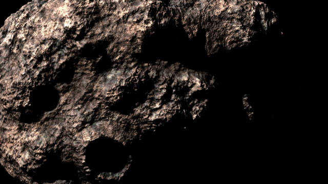 rotating asteroid loop - stone material stock videos & royalty-free footage